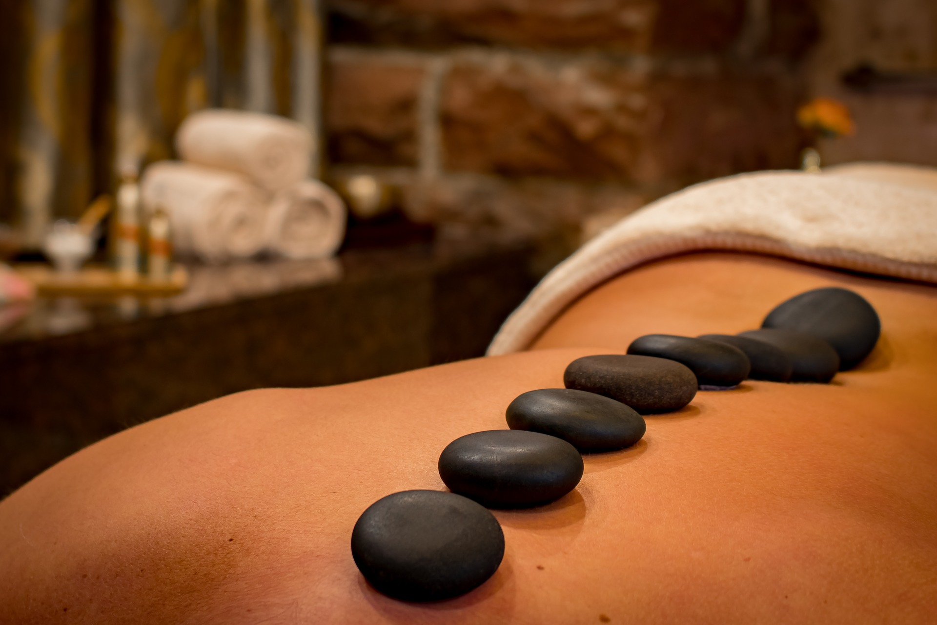 Relaxing massage with hot stones